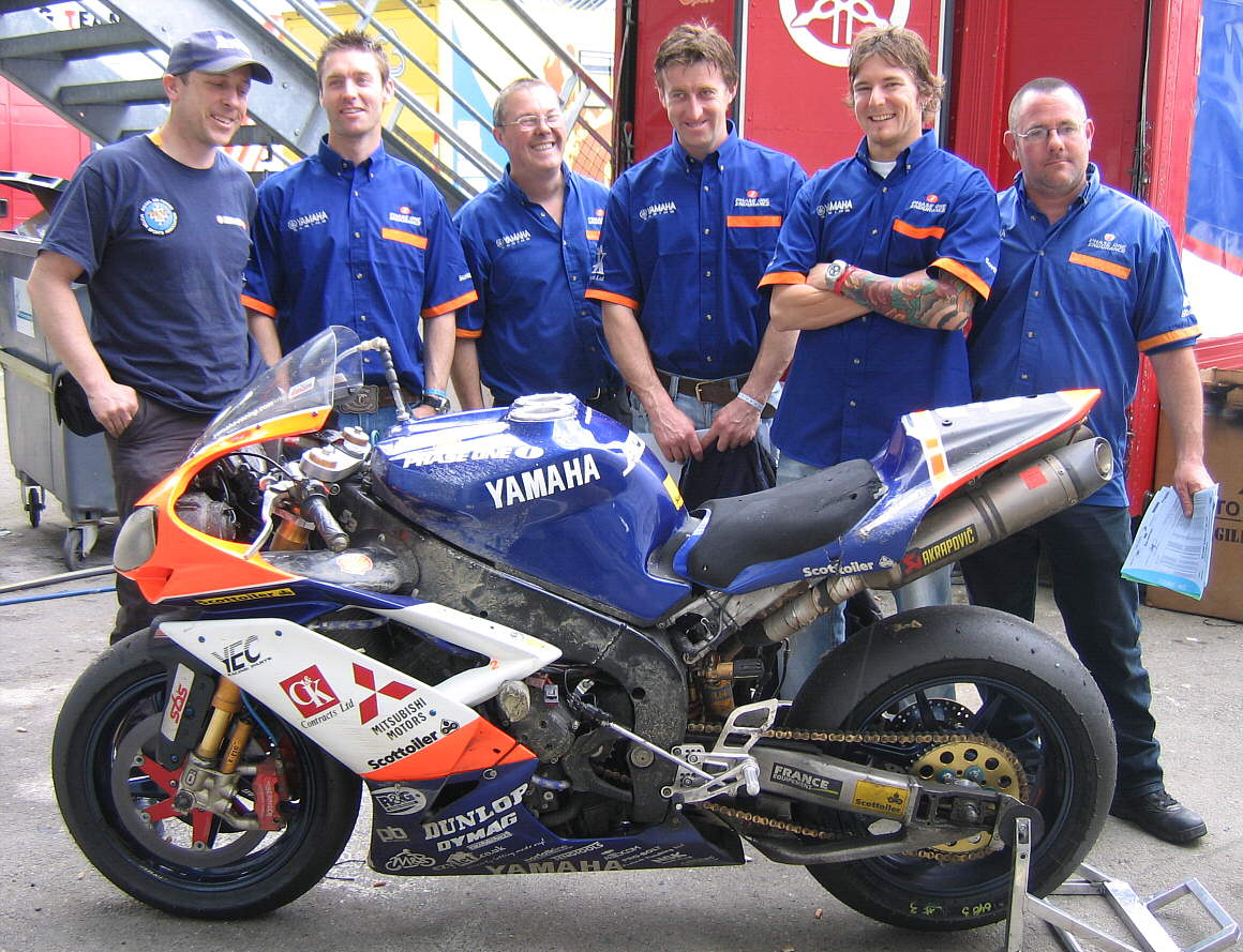 All still happy after getting just 8 points at Le Mans in 2008!  Myself, James Haydon, Russell, James McBride, Damian Cudlin and Steve with a very sorry bike after 24 hours of mechanical torture, bad weather and 2 crashes. Rather pleasingly the HID converted headlamp is still working despite being held in only by cable ties as every single mounting lug has been smashed off in the crashes!  Quality kit fom Mitsubishi/Yamaha!